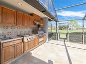 Outdoor Kitchen, a great place to watch some golf while cooking! - Single Family Home for sale at 3959 Prairie Dunes Dr, Sarasota, FL 34238 - MLS Number is A4205907