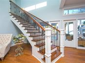 Staircase to second level - Single Family Home for sale at 8101 Midnight Pass Rd, Sarasota, FL 34242 - MLS Number is A4206718