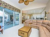 Family room with sliders to Lanai - Single Family Home for sale at 1010 Oak Preserve Ln, Osprey, FL 34229 - MLS Number is A4207598