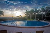 Community Pool near sunset - Condo for sale at Address Withheld, Sarasota, FL 34236 - MLS Number is A4208417