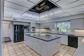 Great Kitchen is adjacent to both dining areas - Single Family Home for sale at 3911 Spyglass Hill Rd, Sarasota, FL 34238 - MLS Number is A4404657