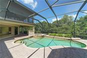 Pool with spa and view of backyard - Single Family Home for sale at 13219 Palmers Creek Ter, Lakewood Ranch, FL 34202 - MLS Number is A4407857