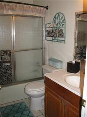 Guest bathroom with tub/shower combination - Single Family Home for sale at 1911 29th St W, Bradenton, FL 34205 - MLS Number is A4409585
