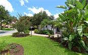 Single Family Home for sale at 6968 Country Lakes Cir, Sarasota, FL 34243 - MLS Number is A4410458