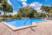 Community Swimming Pool - Condo for sale at 826 Bird Bay Way #112, Venice, FL 34285 - MLS Number is A4413103