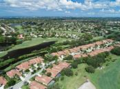 The La Vista Community with views of the Players Course and the Stadium Course. - Villa for sale at 7686 Calle Facil, Sarasota, FL 34238 - MLS Number is A4413755