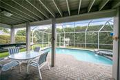 The beautiful pool and spa looking out to the dock and deep water canal. - Single Family Home for sale at 660 Marbury Ln, Longboat Key, FL 34228 - MLS Number is A4415911