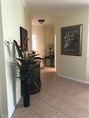 From dining room area, looking toward front door. - Villa for sale at 252 Fairway Isles Ln, Bradenton, FL 34212 - MLS Number is A4417217