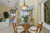 Dinette with Aquarium Window Overlooks Sparkling Pool - Single Family Home for sale at 7060 Whitemarsh Cir, Lakewood Ranch, FL 34202 - MLS Number is A4417363