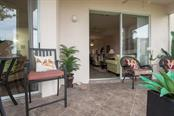 Lanai opens to living area - Condo for sale at 9620 Club South Cir #5110, Sarasota, FL 34238 - MLS Number is A4418081