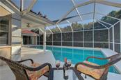 Relax and enjoy the family playing in the pool - Single Family Home for sale at 5167 Kestral Park Ln, Sarasota, FL 34231 - MLS Number is A4421162