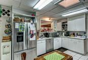 Stainless appliances and and a reverse osmosis water system under the kitchen sink will remain with the home. - Single Family Home for sale at 1509 Flower Dr, Sarasota, FL 34239 - MLS Number is A4421898