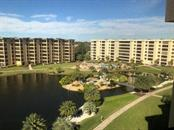 View North of 2nd pool, picnic area, Tiki Hut and BBQ area - Condo for sale at 5780 Midnight Pass Rd #701b, Sarasota, FL 34242 - MLS Number is A4422545