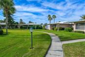 Greenbelt view behind villas. - Villa for sale at 3434 Medford Ln #1110, Sarasota, FL 34239 - MLS Number is A4422897