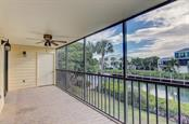 Back Porch overlooking serene canal - Condo for sale at 4115 129th St W #4115, Cortez, FL 34215 - MLS Number is A4424939