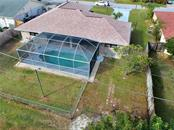 The beautiful pool with brand new screen and cage and the fenced backyard. - Single Family Home for sale at 23265 Mcburney Ave, Port Charlotte, FL 33980 - MLS Number is A4426235