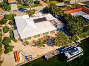 Aerial of back of the house with the views of the canal - Single Family Home for sale at 622 Dundee Ln, Holmes Beach, FL 34217 - MLS Number is A4426329