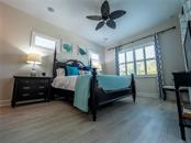 Master suite with driftwood look floors and views of the pool and canal - Single Family Home for sale at 3611 4th Ave Ne, Bradenton, FL 34208 - MLS Number is A4426978