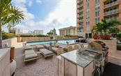 The grilling area on the pool deck - Condo for sale at 1350 Main St #1201, Sarasota, FL 34236 - MLS Number is A4427507