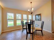 Dining area. - Single Family Home for sale at 2558 Oneida Rd, Venice, FL 34293 - MLS Number is A4428145