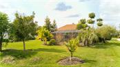 Expansive back yard - Single Family Home for sale at 6321 W Glen Abbey Ln E, Bradenton, FL 34202 - MLS Number is A4429610