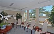 Common room overlooking the recreation and pool deck - Condo for sale at 1350 Main St #1500, Sarasota, FL 34236 - MLS Number is A4433444