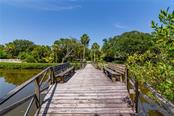 Foot bridge over Heron Lagoon - Single Family Home for sale at 8511 Heron Lagoon Cir, Sarasota, FL 34242 - MLS Number is A4439489