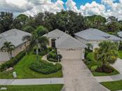 Ariel view of home of lovely landscaped lot - Single Family Home for sale at 348 Melrose Ct, Venice, FL 34292 - MLS Number is A4439531