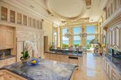 Kitchen overlooking the Gulf of Mexico - Single Family Home for sale at 845 Longboat Club Rd, Longboat Key, FL 34228 - MLS Number is A4440615