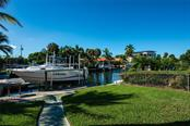 Walkway to the canal with dock and boat lift - Single Family Home for sale at 602 Baronet Ln, Holmes Beach, FL 34217 - MLS Number is A4447974