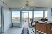 Your screened lanai provides direct access to the pool and beach.  Hurricane shutters provide additional peace of mind. - Condo for sale at 555 The Esplanade N #102, Venice, FL 34285 - MLS Number is A4450635