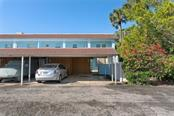Your covered carport space and starage for all your beach toys and bikes is just below the 2nd floor, corner unit - Condo for sale at 4307 Gulf Dr #209, Holmes Beach, FL 34217 - MLS Number is A4452656