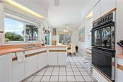 Kitchen with views to Bimini Bay - Single Family Home for sale at 609 N Point Dr, Holmes Beach, FL 34217 - MLS Number is A4455659