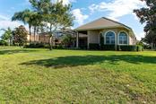 Single Family Home for sale at 7003 Portmarnock Pl, Lakewood Ranch, FL 34202 - MLS Number is A4456343