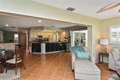 Family room, dinette, kitchen - Single Family Home for sale at 1758 Croton Dr, Venice, FL 34293 - MLS Number is A4459877