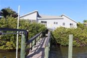 Single Family Home for sale at 7985 Manasota Key Rd, Englewood, FL 34223 - MLS Number is A4462034