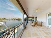 Looking east toward Sarasota Bay and the downtown skyline from the upper terrace. - Single Family Home for sale at 1590 Harbor Sound Dr, Longboat Key, FL 34228 - MLS Number is A4463437