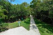 Walking path to fishing dock. - Condo for sale at 515 Forest Way, Longboat Key, FL 34228 - MLS Number is A4465231
