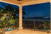 Balcony off Game room with view of downtown/Ringling bridge, fireplace - Single Family Home for sale at 1418 John Ringling Pkwy, Sarasota, FL 34236 - MLS Number is A4467093