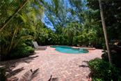 Heated pool and spa with large deck area - Single Family Home for sale at 97 52nd St, Holmes Beach, FL 34217 - MLS Number is A4468151