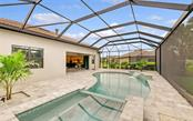 Heated spa, garden boxes. - Single Family Home for sale at 11057 Sandhill Preserve Dr, Sarasota, FL 34238 - MLS Number is A4469925