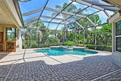 Huge Covered Pool Area Lake Front with Spa - Single Family Home for sale at 9025 Rocky Lake Ct, Sarasota, FL 34238 - MLS Number is A4470339