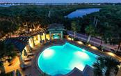 Stunning sunsets from Gulf front tiki tables - Condo for sale at 1300 Benjamin Franklin Dr #708, Sarasota, FL 34236 - MLS Number is A4471978