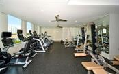 Fitness center overlooks the pool deck - Condo for sale at 1350 Main St #1001, Sarasota, FL 34236 - MLS Number is A4472708