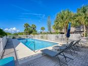 Community pool for relaxing and exercise - Single Family Home for sale at 500 Beach Rd #1, Sarasota, FL 34242 - MLS Number is A4474527