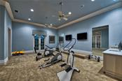 Fitness Room with Wet Bar - Single Family Home for sale at 8499 Lindrick Ln, Bradenton, FL 34202 - MLS Number is A4475594