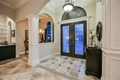 Elegeant foyer with double entry solid wood and glass doors - Single Family Home for sale at 14507 Leopard Crk, Lakewood Ranch, FL 34202 - MLS Number is A4478709