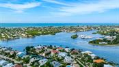Aerial west view into Bimini Bay and the Gulf of Mexico beyond - Single Family Home for sale at 718 Key Royale Dr, Holmes Beach, FL 34217 - MLS Number is A4480381