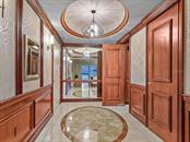 A gracious foyer greets you at the entrance to the apartment. - Condo for sale at 1111 Ritz Carlton Dr #1506, Sarasota, FL 34236 - MLS Number is A4480943
