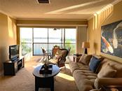 Living Room opens to Balcony with Bay Views - Condo for sale at 9011 Midnight Pass Rd #328, Sarasota, FL 34242 - MLS Number is A4483601